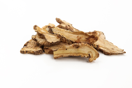 Angelica sinensis slices on white background 스톡 콘텐츠