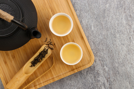 tea set on wooden plate on cement background 스톡 콘텐츠
