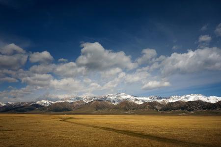 bole: Snow mountain grassland Road