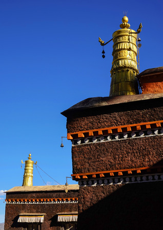 the abbot: View of roof of the temple under the blue sky