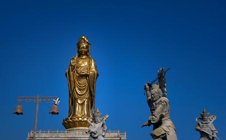 Golden Guan Yin statues Stock Photo