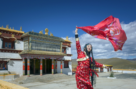 beautiful woman with traditional chinese costume at Tibetan temple