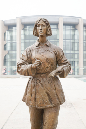 Woman writer statues