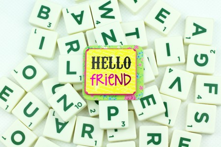 puzzling: greeting note with Plastic tile alphabet for puzzling words games Stock Photo