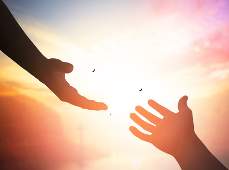 ministration: Hand offering for help on a bright background Stock Photo