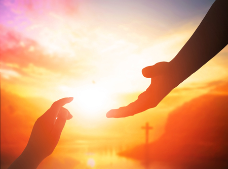 Hand offering for help on a bright background Standard-Bild