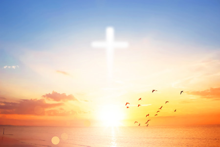 Cross on colorful sunset sky background