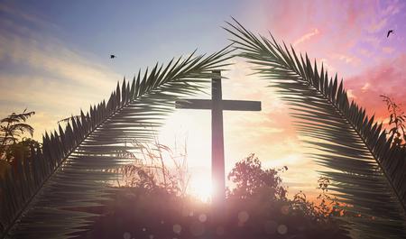 Religious cross over the sunset