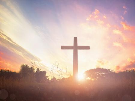 Jesus christ mercy at cross on mountain sunset background