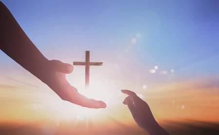 Jesus helping hand concept: World Peace Day on sunset background 免版税图像 - 112807527