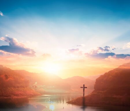 Jesus Christ Cross Concept: Crucifixion Of Jesus Christ Cross At Sunset background Stock fotó