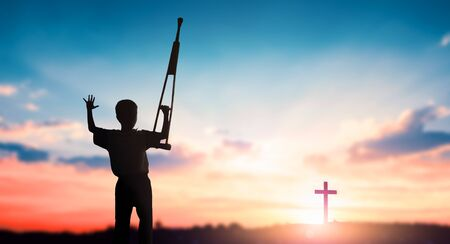 Easter concept: Disabled people and the cross of Jesus