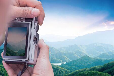 World Tourism Day concept: take a photo mountain view