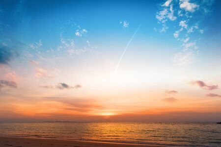 Background of colorful sky concept: Beautiful tropical sunrise on the beach