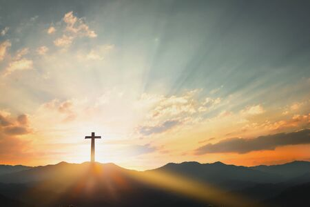 Good Friday concept: cross with sunset in the sky background Imagens