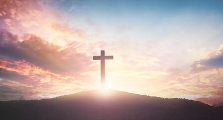 Easter concept: The cross on mountain sunset background Stock Photo