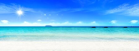 World Oceans Day concept: Beautiful beach with white sand, turquoise ocean water and blue sky with clouds in sunny day 免版税图像