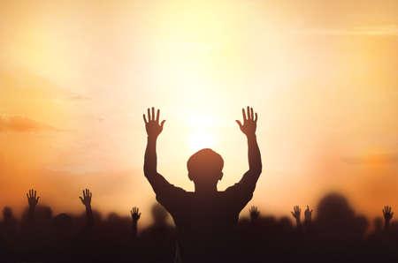 Worship concept: christian people Raise hand over cross on spiritual sky background