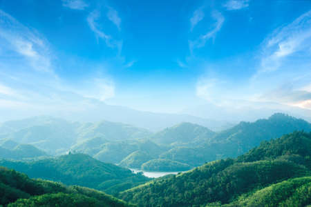 World environment day concept: Green mountains and beautiful blue sky clouds 免版税图像