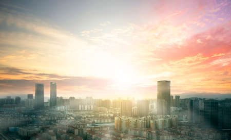 City day concept: view of Sunset over cityscape background