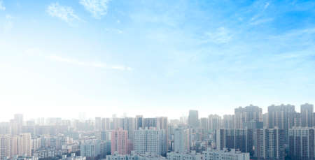 World Cities Day concept: real estate modern city urban skyline under blue sky