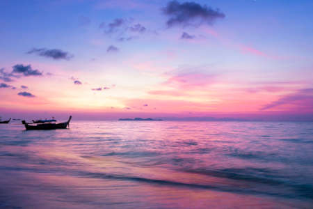 Sunrise sky background concept: Traditional Thai long tail boat at beautiful sunrise background