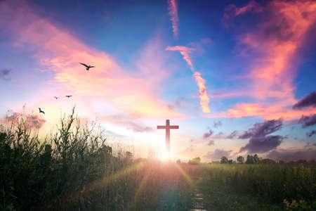 Easter concept: Concept: cross on sunset sky background 版權商用圖片