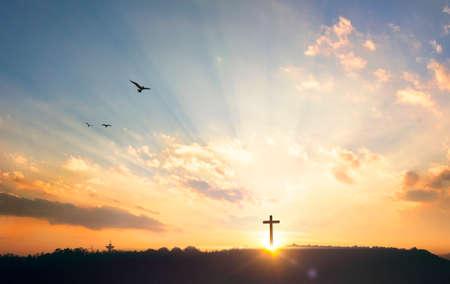 Silhouette cross on the mountain at sunset 版權商用圖片