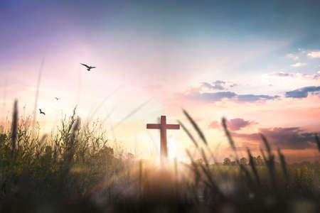 Religious cross concept: Silhouette cross on mountain at sunset background 版權商用圖片