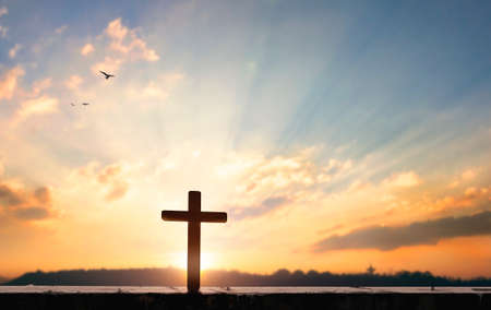Religious concept: Silhouette cross on at sunset background