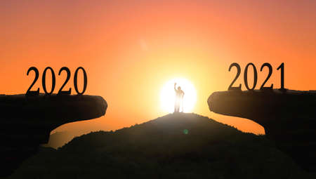 2021 concept: Silhouette of year 2021 and disabled person on mountain with city sunset background