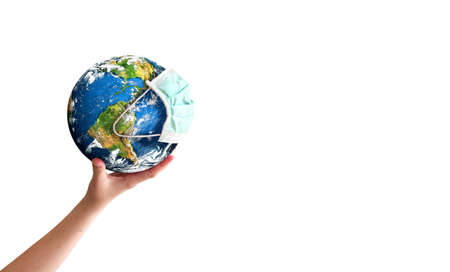 Earth Day concept: hand holding earth globe with a face mask isolated on a white background. 版權商用圖片