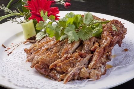 Roasted leg of lamb on white plate  photo
