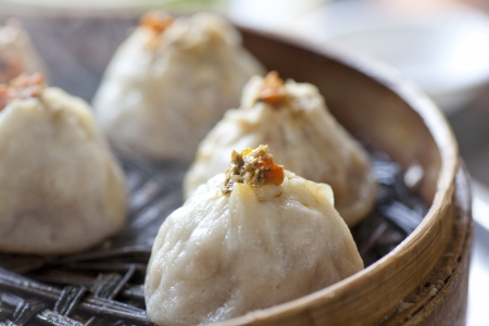 Chinese food, steamed bun in bamboo steamer photo