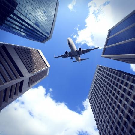 Modern city buildings and aircraft in Brisbane Archivio Fotografico