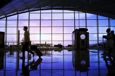 lounge: Airport terminal hall, walking travelers