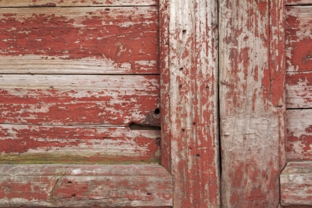 flaking: Damage to the red paint wooden doors
