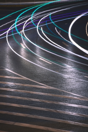 Urban road car light trails photo