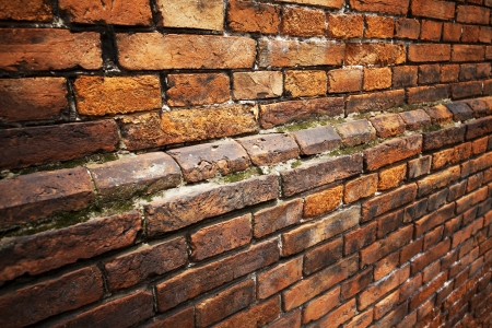 Red brick background: closeup of an old uneven brick wall. Stock Photo