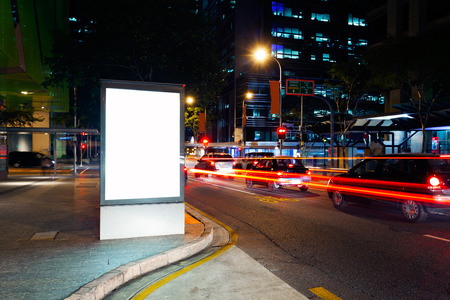 billboard background: Advertising light boxes in the city at night  Stock Photo