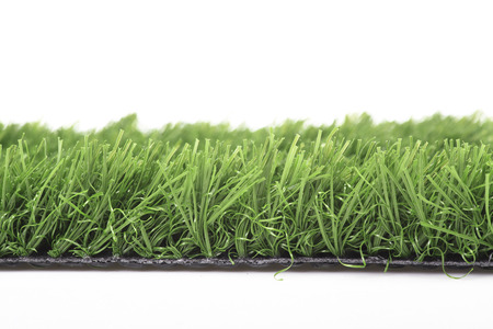 Plastic lawn on a white background photo