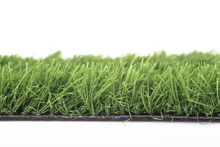 Plastic lawn on a white background Standard-Bild