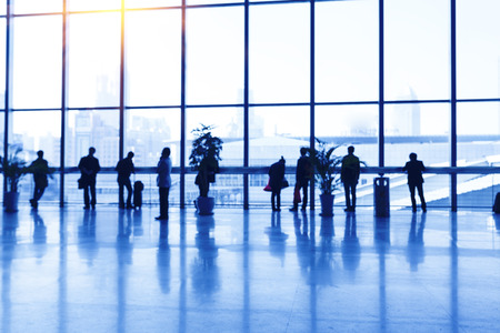airport business: Silhouette of people in airport