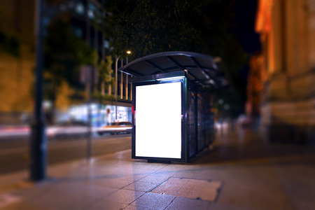 grungy background: Advertising light boxes in the city at night Stock Photo