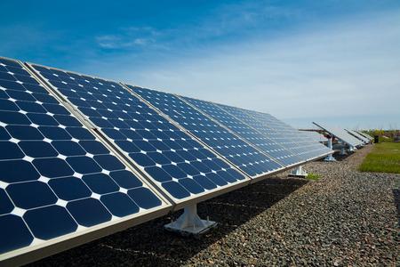 Solar panels aligned work 写真素材