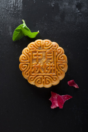Chinese moon cake on a black background Stock Photo