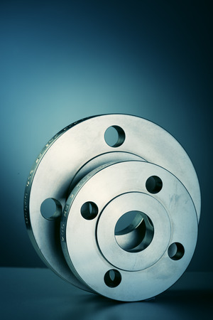 Blue tones of the industrial metal flange, more than a combination and flange close-up