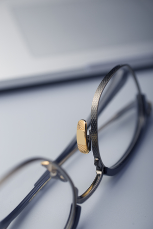 The fashionable metal frame glasses are in the white background