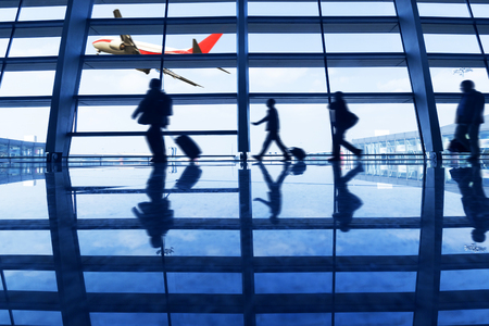 modern airport lobby with busy travelers Stock Photo