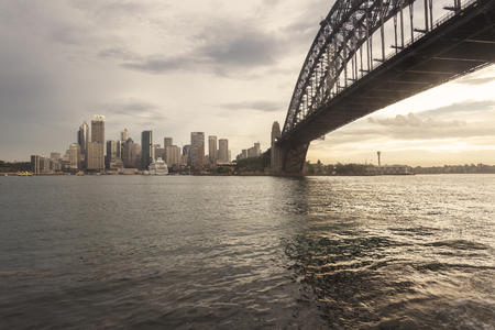 Sydney city skyline, Big Iron Bridge and cityscape collection in the early evening Archivio Fotografico - 105144134